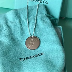 """Tiffany & Co. Jewelry - Tiffany & Co. Silver LG Initial """"T"""" Disc Necklace."""